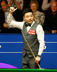 Ding Junhui celebrates his quarter final win against Ronnie O'Sullivan, on day twelve of the Betfred Snooker World Championships at the Crucible Theatre, Sheffield.