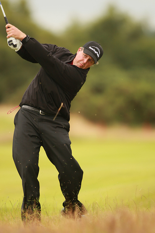 CARNOUSTIE, SCOTLAND - JULY 19:  Phil Mickelson follows through on an approach shot during the first round of the 136th Open Championship in Carnoustie, Scotland at Carnoustie Golf Links on Thursday, July 19, 2007. (Photo by Darren Carroll/Getty Images) *** LOCAL CAPTION *** Phil Mickelson