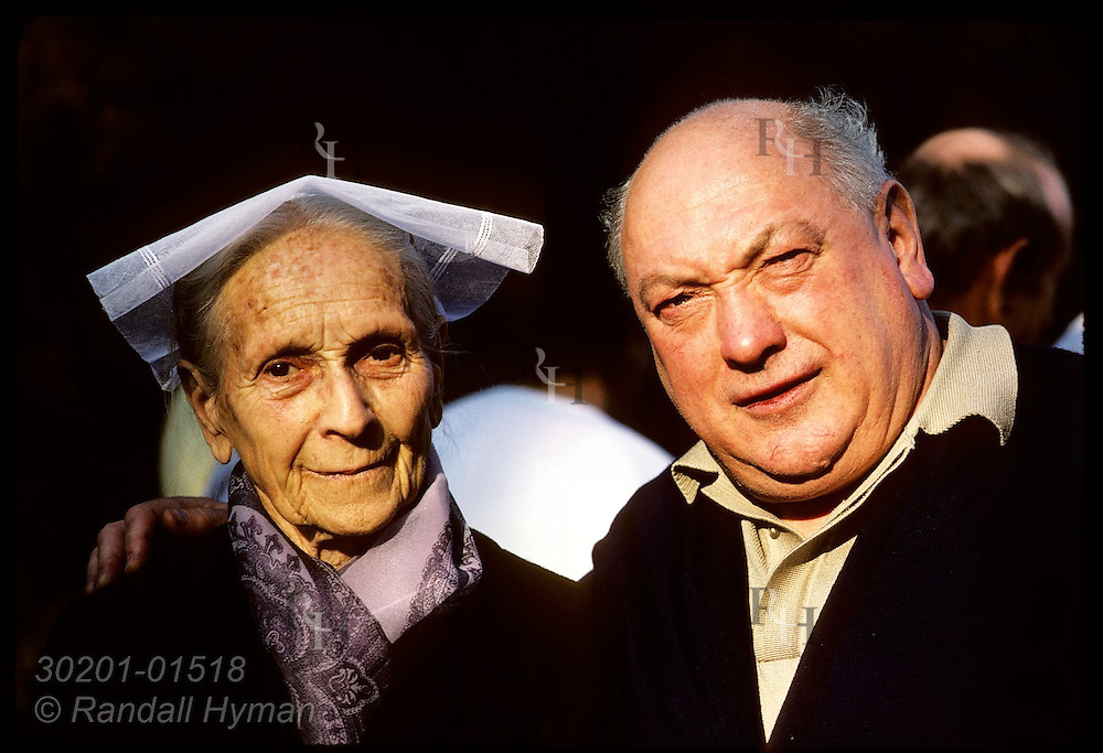 Man posing w/ his elderly mother; town of Crac'h, Morbihan, Brittany. France