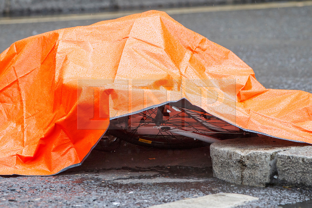 © Licensed to London News Pictures. 22/06/2015. London, UK. Bicycle of a female cyclist who died in a crash with a tipper truck at Bank junction in London during morning rush hour on Monday, June 22, 2015. Photo credit: Tolga Akmen/LNP