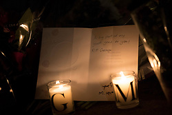 © Licensed to London News Pictures. 26/12/2016. Goring-, UK. Candles illuminate a written tribute to George Michael placed at the front door of his house in Goring. Pop superstar George Michael died on Christmas day at his Oxfordshire home on the River Thames aged 53. Photo credit: Peter Macdiarmid/LNP