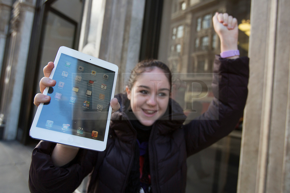 © licensed to London News Pictures. London, UK 02/11/2012. A new iPad Mini owner Krysta Cutajar posing with her tablet outside Apple Store on Regent Street, London as highly anticipated tablet meets the costumers on 02/11/12. Photo credit: Tolga Akmen/LNP