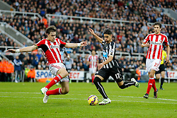 Ayoze Perez of Newcastle United is challenged by Sebastian Coates of Sunderland - Photo mandatory by-line: Rogan Thomson/JMP - 07966 386802 - 21/12/2014 - SPORT - FOOTBALL - Newcastle upon Tyne, England - St James' Park - Newcastle United v Sunderland - Tyne-Wear derby - Barclays Premier League.