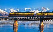 Winter scenic of the Alaska Railroad crossing the bridge over Twentymile River, Turnagain Arm.
