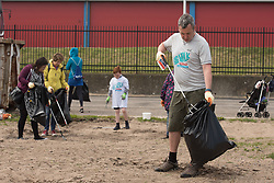 The Big Walk, organised by the Eden Project, came to Portobello this morning. Four people set off from Morecambe to walk home to each of the nations of the UK. Scotland's representative is Angis McLeod from Dundee and this morning he met with representatives from local groups in Portobello, as well as taking part in a small litter clean-up and leading some community singing at the end of the Prom.  Pictured: Angus Mcleod<br /> <br /> <br /> © Jon Davey/ EEm