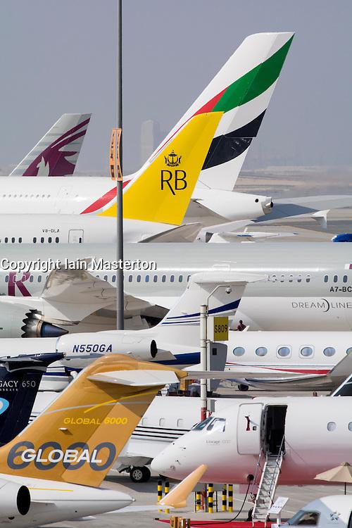 Many civilian and military aircraft on apron at Al Maktoum International airport during Dubai Airshow 2013 in United Arab Emirates