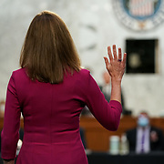 President Donald Trump's Supreme Court nominee Judge Amy Coney Barrett is sworn in during her Senate Judiciary confirmation hearing on Monday, October 12, 2020.