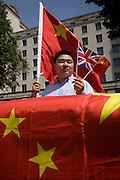 During the official visit by the Chinese Premier Li Keqiang, Chinese nationals show support to a Beijing-London political and economic relationship, by holding flags in the street outside the Ministry of Defence  on Whitehall, Westminster, London.