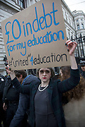 Protester dressed up as Prime Minister Theresa May holds up a sign National Union of Students (NUS) and the University and College Union (UCU) demonstration 'United For Education' calling for free, accessible and quality further and higher education across the UK, and to demand an end to the marketisation of university and college education on 19th November 2016 in London, United Kingdom. (photo by Mike Kemp/In Pictures via Getty Images)