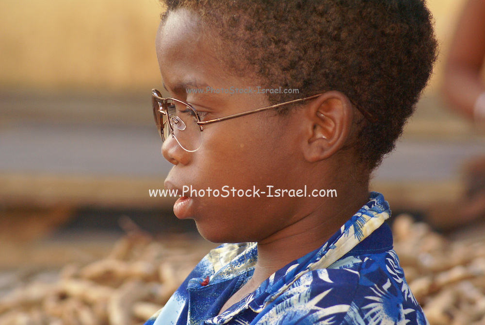 Madagascar, A portrait of a young Madagascan boy with eye glasses