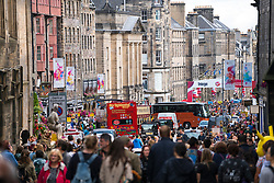 View along High Street with many people on a busy day at the Edinburgh Fringe Festival 2016, Scotland, United Kingdom