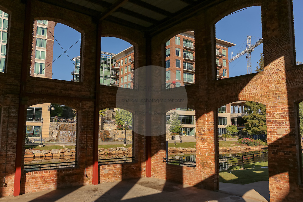 Art Crossing and River Place development seen from the Wyche Pavilion on the Reedy River in downtown Greenville, South Carolina.