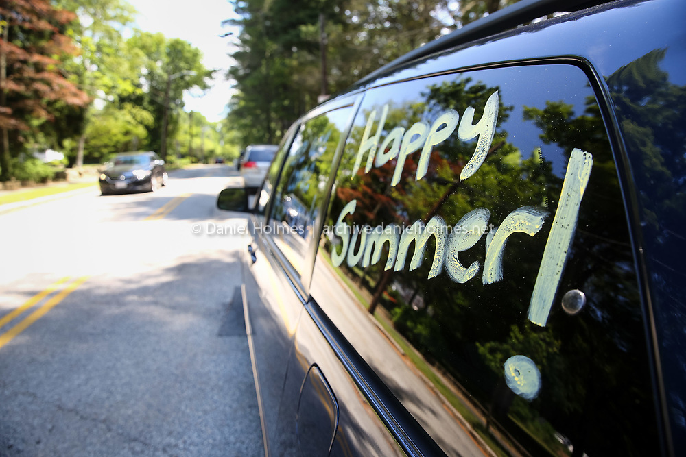 """(6/20/16, HOPEDALE, MA) A minivan waiting to pick up a student has """"Happy Summer!"""" written on the window on the last day of school at  at Memorial School in Hopedale on Monday. Daily News and Wicked Local Photo/Dan Holmes"""