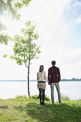Couple holding hands lake shore romantic