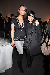 Left to right, SAFFRON ALDRIDGE and SHARLEEN SPITERI at an exhibition of photographs by Miles Aldridge held at Hamiltons, Carlos Place, London on 31st March 2009.