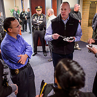 111214       Cable Hoover<br /> <br /> New Mexico State Police major Darren Soland, center, shares cake with his fellow officers at his retirement ceremony at NMSP headquarters in Santa Fe Wednesday.