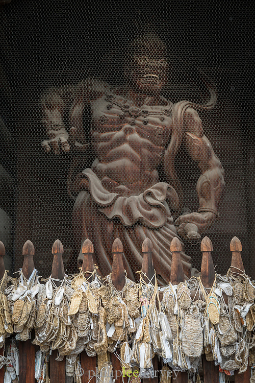 Close-up of statue at temple captured from low angle, Nagano, Japan