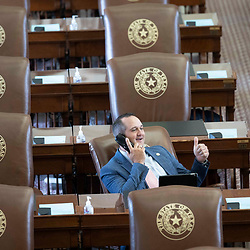 State Rep. Ernest Bailes, R-Shepherd, sits in the chamber on the second day of failing to get a quorum at a special session. Most Democratic members left the state protesting of restrictive voting measures proposed byTexas Gov. Greg Abbott.