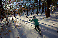 Jessica Laman (age 9) cross country skiing in the New England woods.