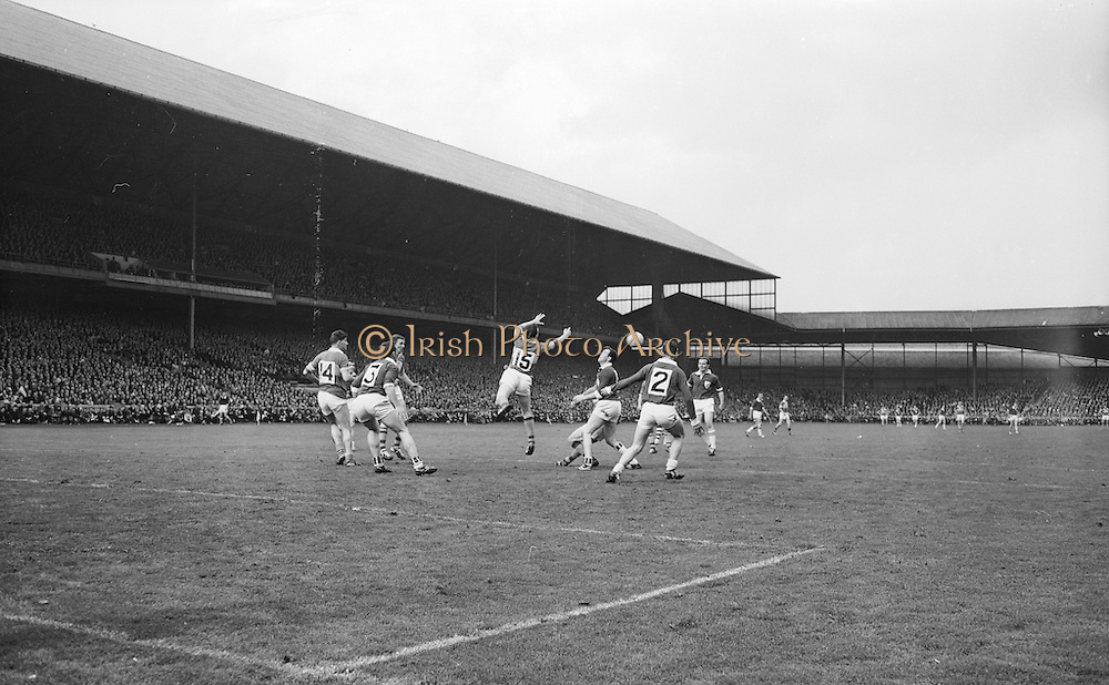 Kerry's J.J. Barrett punches ball to team mate during the All Ireland Senior Gaelic Football Final Kerry v. Galway in Croke Park on the 26th September 1965. Galway 0-12 Kerry 0-09.<br /> Headline:Kerry player punches ball to teammate during the Kerry v. Galway All Ireland Senior Gaelic Football Final, 26th September 1965.