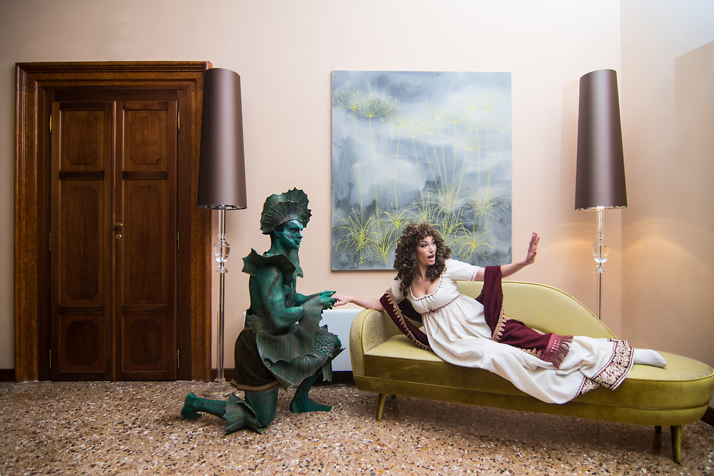 """Venice, February 2019<br /> Models pose wearing a """"Mervelleuse"""" dress, worn by Vanessa Busca, made following an original print of the late 1700s, in poplin and silk, and a Reptilian dress, that is a free interpretation on the theme """"Sea Monster"""" which recalls the characters of """"Spazio 1999"""". <br /> The theme for the 2019 edition of Venice Carnival is 'Venice, the oldest city of the future!' and will run from 16th of February to 5th of March 2019."""