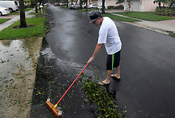 The Vineyards in Monarch Lakes President Felix Carballo cleans up after Hurricane Irma left South Florida, sparing the Miramar community's houses major damage, other than down trees, branches and mailboxes on Sunday, September 10, 2017. Photo by Taimy Alvarez/Sun Sentinel/TNS/ABACAPRESS.COM