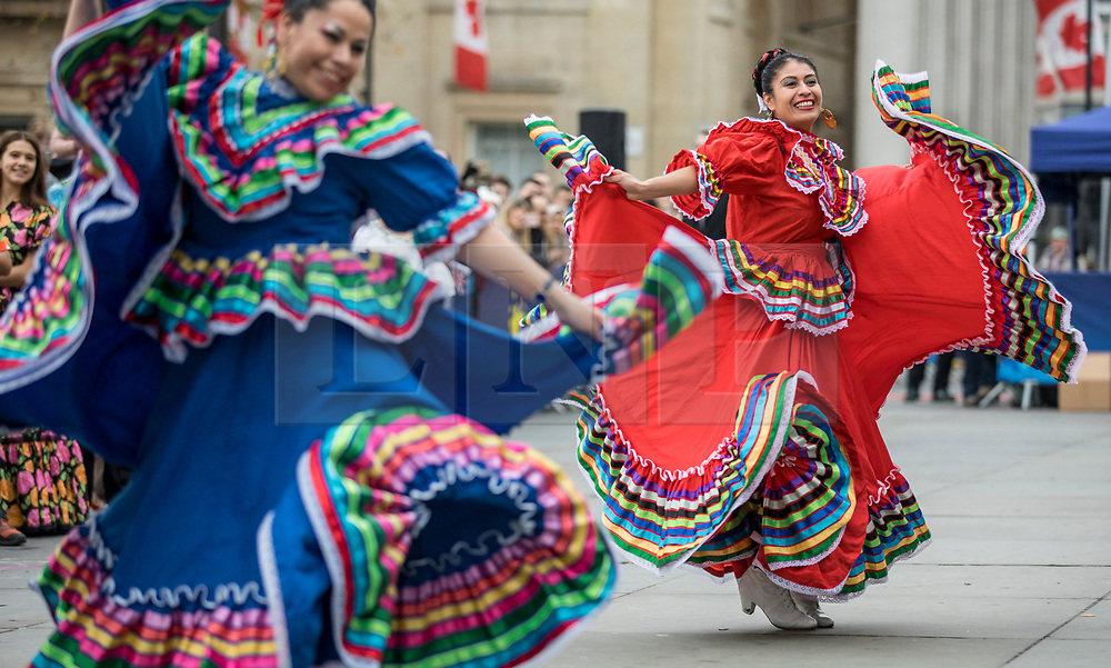 © Licensed to London News Pictures. 30/12/2018. London, UK. Two dancers from Carnaval Del Pueblo, a dance group from across Latin America, performs at a preview ahead of the London New Year's Day Parade. More than 8,000 performers from 26 countries will take part in the parade on 1st January 2019. Photo credit: Rob Pinney/LNP