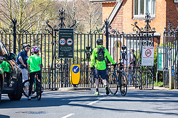 © Licensed to London News Pictures. 05/04/2020. London, UK. Cyclists turn away as Richmond Park bans cycling. Members of the public come out to exercise as temperatures reach 21c this weekend. Richmond Park seems quieter after the Government urged the public not to leave home during the fine weather as the Coronavirus crisis continues. Photo credit: Alex Lentati/LNP