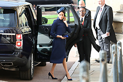 The Duchess of Sussex arrives ahead of the wedding of Princess Eugenie to Jack Brooksbank at St George's Chapel in Windsor Castle.