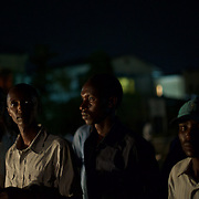 "University students from Bujumbura University wander the street outside the American embassy in Burundi's capital, hours after being asked to leave the embassy grounds. Early in the day, hundreds of students stormed the embassy grounds seeking refuge from a police advance after a 24 hour deadline to abandon the area expired. The students moved to the area in early May because, they claim, the US authorities ensure their security, after their university was closed amid anti-government protests. The government closed the university at the end of April, citing ""insecurity""."
