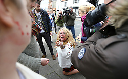 © Licensed to London News Pictures. 29/04/2017. Hartlepool UK. A UKIP supporter kneeling on the floor with blood on her face after a fight breaks out between Pro EU campaigners North East for Europe and UKIP party supporters in Hartlepool, County Durham, before UKIP leader Paul Nuttall heads out on the campaign trail. Photo credit: Andrew McCaren/LNP
