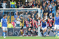 Sheffield United midfielder Mark Duffy (21) celebrates his goal 2-3 with Sheffield Wednesday goalkeeper Keiren Westwood (1) looking on during the EFL Sky Bet Championship match between Sheffield Wednesday and Sheffield Utd at Hillsborough, Sheffield, England on 24 September 2017. Photo by Phil Duncan.