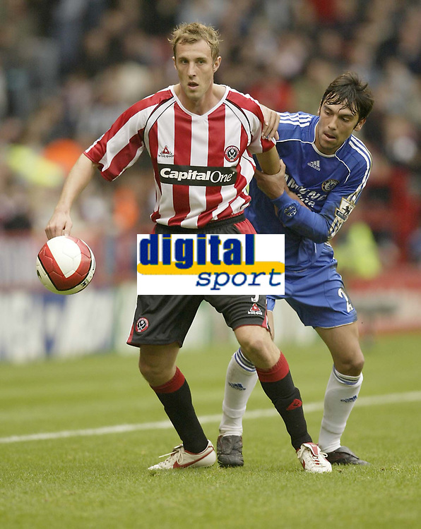 Photo: Aidan Ellis.<br /> Sheffield United v Chelsea. The Barclays Premiership. 28/10/2006.<br /> Sheffield's Rob Hulse is watched closely by Chelsea's Paulo Ferreira