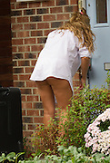 EXCLUSIVE<br /> Model and TV star of Gypsy Weddings Danielle Mason and sister of Eastenders star Jessie Wallace returns home after what looks like a night away!! wearing just a shirt and Thong as she took her case from her car , Danielle is said to have set her sights on BB star Bear!<br /> ©Exclusivepix Media