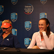 Martina Hingis, Switzerland, (right), at the press conference after her doubles match loss with team mate Daniela Hantuchova, Slovakia, against Cara Black and Vania King who won 6-3 6-1 during the New Haven Tennis Open at Yale, Connecticut, USA. 20th August 2013. Photo Tim Clayton