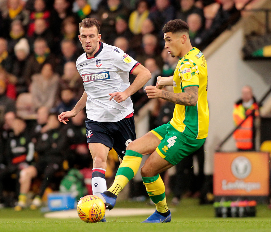 Bolton Wanderers' Christian Doidge chases down Norwich City's Ben Godfrey<br /> <br /> Photographer David Shipman/CameraSport<br /> <br /> The EFL Sky Bet Championship - Norwich City v Bolton Wanderers - Saturday 8th December 2018 - Carrow Road - Norwich<br /> <br /> World Copyright © 2018 CameraSport. All rights reserved. 43 Linden Ave. Countesthorpe. Leicester. England. LE8 5PG - Tel: +44 (0) 116 277 4147 - admin@camerasport.com - www.camerasport.com
