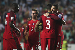 October 10, 2017 - Lisbon, Portugal - Portugal's forward Cristiano Ronaldo (R) celebrating their victory  with temmates during the FIFA 2018 World Cup Qualifier match between Portugal and Switzerland at the Luz Stadium on October 10, 2017 in Lisbon, Portugal. NURPHOTO / CARLOS COSTA  (Credit Image: © Carlos Costa/NurPhoto via ZUMA Press)