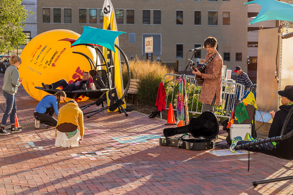 Zach performs on Main Street during the prototyping activities