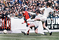 Duncan McKenzie (Forest) Norman Hunter and Terry Cooper (Leeds) try to stop his cross. Nottingham Forest v Leeds United. 26/9/71 Credit : Colorsport