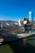 Frank Gehry's Guggenheim Museum, The Spider sculpture, Iberdrola Tower and River Nervion at Bilbao, Spain