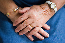 Older persons with hands on their lap,