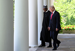 US President Donald Trump and Nigerian President Muhammadu Buhari walk the Colonnade of the White House on April 30, 2018 in Washington, DC. Photo by Olivier Douliery/Abaca Press