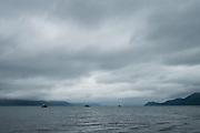Boats sit under storm clouds on Rescurrection Bay, Seward, Alaska