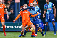 Wycombe Wanderers midfielder Curtis Thompson holds back Luton Town midfielder Luke Berry during the EFL Sky Bet League 1 match between Luton Town and Wycombe Wanderers at Kenilworth Road, Luton, England on 9 February 2019.