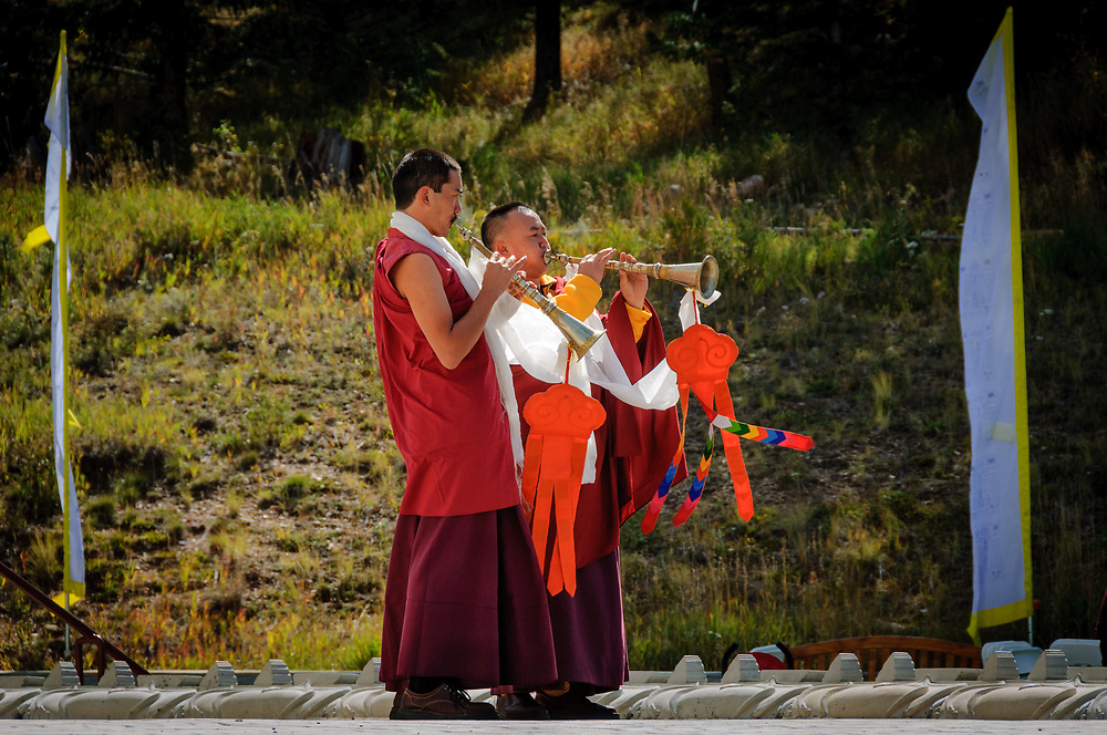 Tibetan trumpeters at The Great Stupa of Dharmakaya, the largest Buddhist monument in the United States.