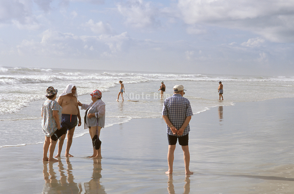 People socializing at the beach