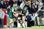 New Zealand's Kevin Proctor is tackled by Australia's Johnathan Thurston during the Ladbrokes Four Nations match between Australia and New Zealand at Anfield, Liverpool, England on 20 November 2016. Photo by Craig Galloway.