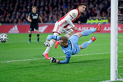 Dusan Tadic #10 of Ajax and Marco Bizot #1 of AZ Alkmaar in action during the Dutch Eredivisie match round 25 between Ajax Amsterdam and AZ Alkmaar at the Johan Cruijff Arena on March 01, 2020 in Amsterdam, Netherlands
