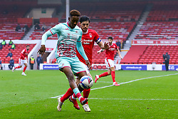 Jamal Lowe of Swansea City brings the ball under control, pressured by Scott McKenna of Nottingham Forest  - Mandatory by-line: Nick Browning/JMP - 29/11/2020 - FOOTBALL - The City Ground - Nottingham, England - Nottingham Forest v Swansea City - Sky Bet Championship