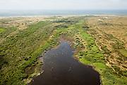 Nederland, Noord-Holland, Texel, 14-07-2008; Nationaal Park Duinen van Texel, De Hors, met in de voorgrond vogels boven het brakke water van de Geul; de strandvlakte is ontstaan uit aan het eiland vast geraakte zandplaten; zandplaat, strand, zand, stuiven. .luchtfoto (toeslag); aerial photo (additional fee required); .foto Siebe Swart / photo Siebe Swart